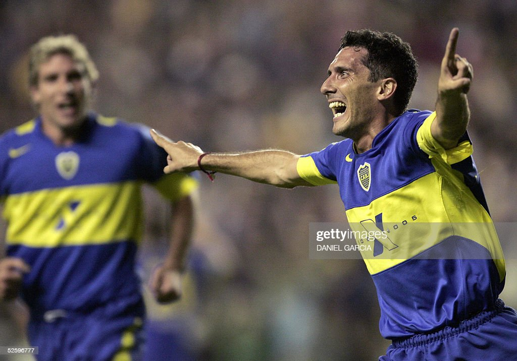Boca Juniors' Diego Cagna celebrates after scoring the first goal against Pachuca followed by teammate Martin Palermo 06 April 2005 during their...