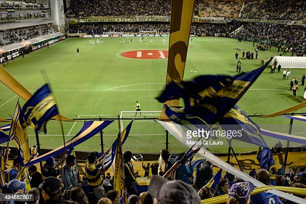 Boca Juniors football team fans and hooligans from 'The Twelve Barra Brava' chant slogans to support their team during a match between Boca and the...