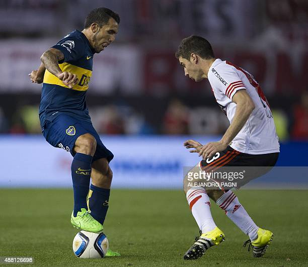 Boca Juniors' forward Carlos Tevez controls the ball in front of River Plate's forward Lucas Alario during their Argentina First Division football...