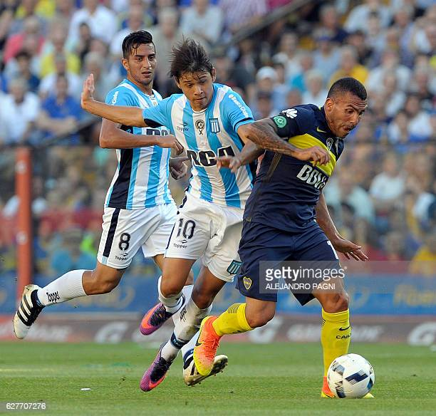 Boca Juniors' forward Carlos Tevez vies for the ball with Racing Club's midfielder Oscar Romero during their Argentina First Division football match...