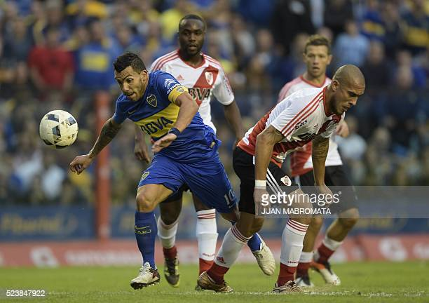 Boca Juniors' forward Carlos Tevez vies for the ball with River Plate's defender Jonathan Maidana during their Argentine first division football...
