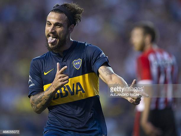Boca Juniors' forward Daniel Osvaldo celebrates after scoring the team's second goal against Estudiantes during their Argentina First Division...