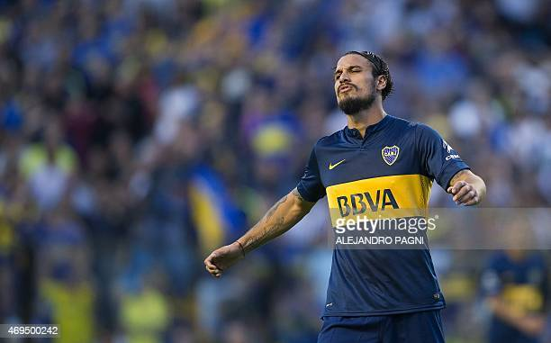 Boca Juniors' forward Daniel Osvaldo reacts after missing a goal opportunity against Nueva Chicago during their Argentina First Division football...