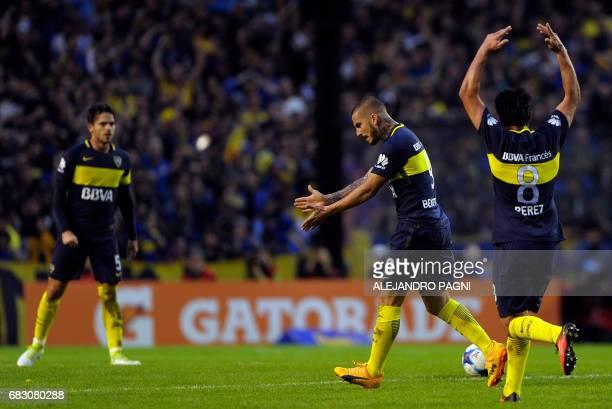 Boca Juniors' forward Dario Benedetto and midfielder Pablo Perez celebrates after midfielder Fernando Gago scored a free kick against River Plate...