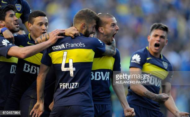Boca Juniors' forward Dario Benedetto celebrates after scoring a goal against Quilmes during their Argentina First Division football match at La...