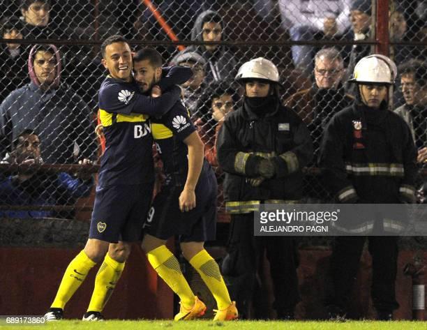 Boca Juniors' forward Dario Benedetto celebrates with his teammate defender Leonardo Jara after scoring a goal against Huracan during their Argentina...