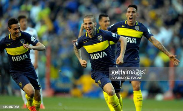 Boca Juniors' forward Dario Benedetto celebrates with teammates after scoring the team's second goal against Quilmes during their Argentina First...