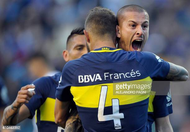 Boca Juniors' forward Dario Benedetto celebrates with teammates after scoring a goal against Quilmes during their Argentina First Division football...