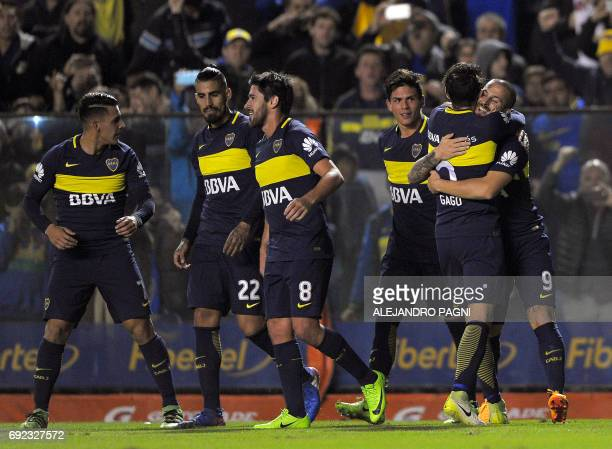Boca Juniors' forward Dario Benedetto celebrates with teammates after scoring by penalty kick against Independiente during their Argentina first...