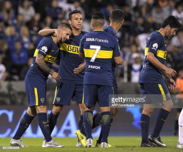 Boca Juniors' forward Dario Benedetto celebrates with teammates after forcing an own goal by Velez Sarsfield's midfielder Nicolas Dominguez during...
