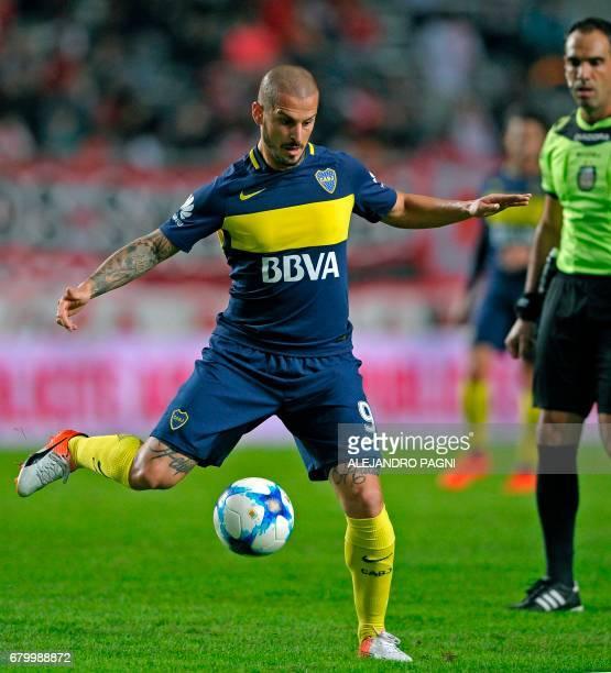Boca Juniors' forward Dario Benedetto controls the ball during their Argentina First Divsion football match against Estudiantes at Ciudad de La Plata...