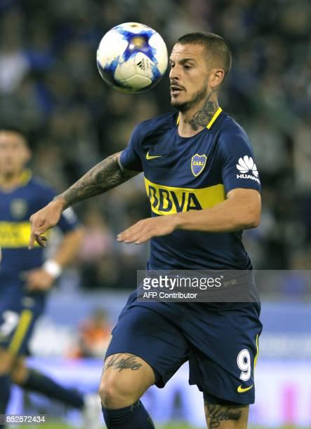 Boca Juniors' forward Dario Benedetto controls the ball during their Argentina First Division Superliga football match against Velez Sarsfield at...