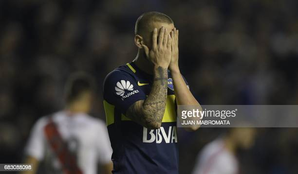 Boca Juniors' forward Dario Benedetto reacts after missing goal opportunity against River Plate during their Argentina first division football match...