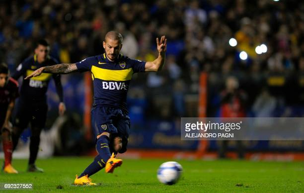 Boca Juniors' forward Dario Benedetto shoots to score a penalty kick against Independiente during their Argentina first divsion football match at La...