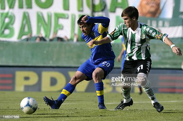 Boca Juniors' forward Dario Cvitanich vies for the ball with Banfield's defender Nicolas Tagliafico during their Argentina's First Division football...