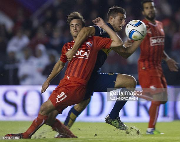 Boca Juniors' forward Jonathan Calleri vies for the ball with Independiente's defender Nicolas Tagliafico during their Argentina First Division...