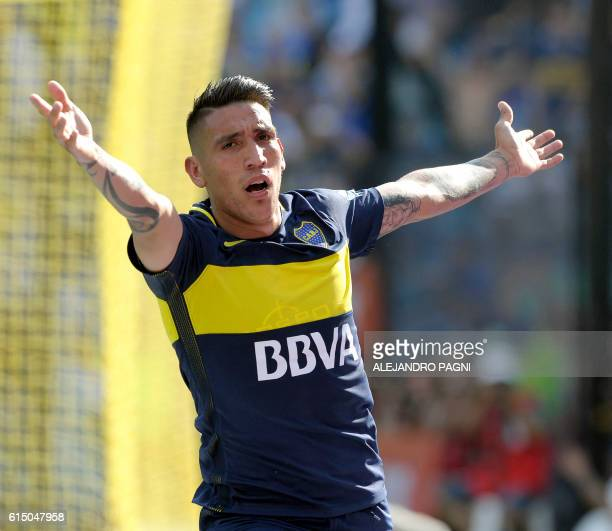 Boca Juniors' forward Ricardo Centurion celebrates after scoring against Sarmiento during their Argentina First Division football match at the La...
