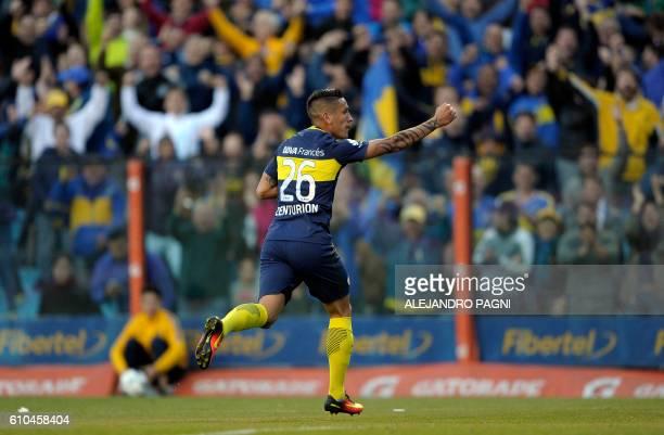 Boca Juniors' forward Ricardo Centurion celebrates after scoring the team's third goal against Quilmes during their Argentina First Division football...