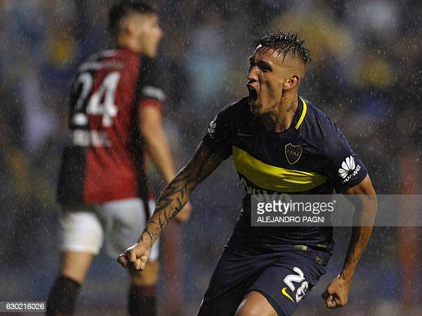 Boca Juniors' forward Ricardo Centurion celebrates after scoring the team's third goal against Colon during their Argentina First Division football...
