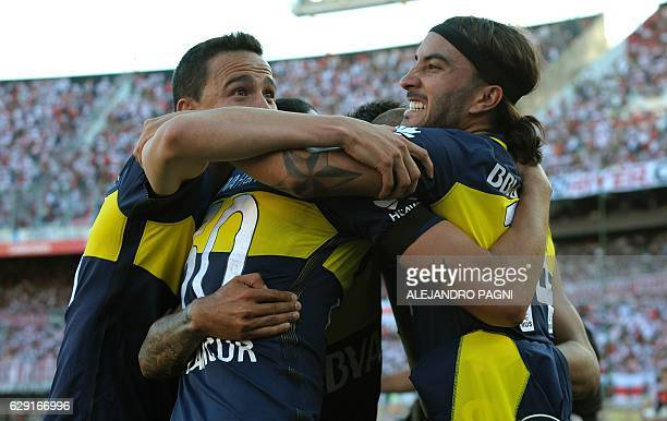 Boca Juniors' forward Ricardo Centurion celebrates with teammates after scoring the team's fourth goal against River Plate during their Argentina...