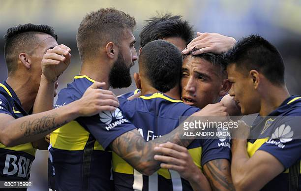 Boca Juniors' forward Ricardo Centurion celebrates with teammates after scoring against Colon during their Argentina First Division football match at...