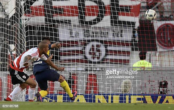 Boca Juniors' forward Ricardo Centurion heads the ball to score the team's fourth goal against River Plate during their Argentine first division...