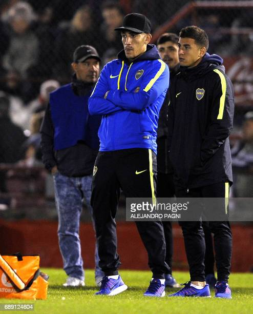 Boca Juniors' forward Ricardo Centurion injured and denounced by his girlfriend for gender violence watches his teammates warm up ahead of their...