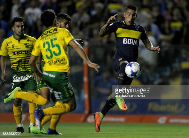 Boca Juniors' forward Ricardo Centurion vies for the ball with Defensa y Justicia's midfielder Mariano Bareiro during their Argentina First Division...