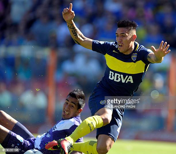 Boca Juniors' forward Ricardo Centurion vies for the ball with Temperley's goalkeeper Matias Ibanez during their Argentina First Division football...