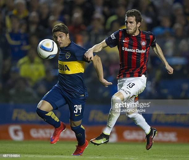 Boca Juniors' forward Sebastian Palacios vies for the ball with San Lorenzo's defender Ramiro Arias during their Argentina First Division football...