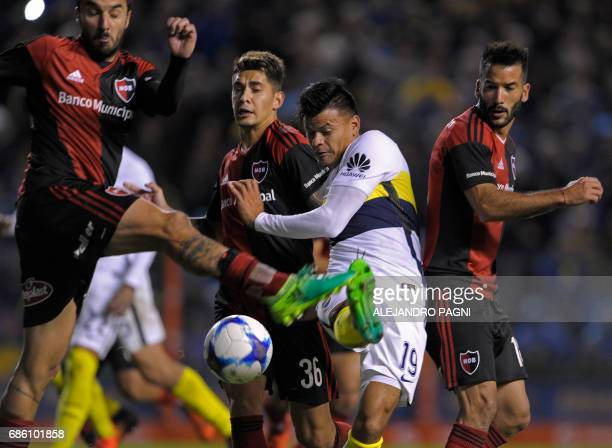 Boca Juniors' forward Walter Bou vies for the ball with Newell's Old Boys forward Ignacio Scocco during their Argentina First Divsion football match...