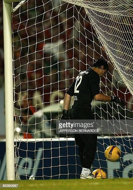 Boca Juniors' goalie Javier Garcia fetches the ball from the net on October 22 2009 in Porto Alegre Brazil during their Copa Sudamericana...