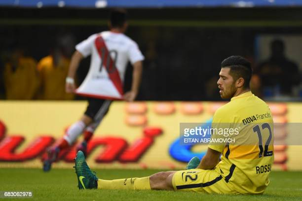 Boca Juniors' goalkeeper Agustin Rossi reacts after River Plate's midfielder Gonzalo Martinez scored a goal during their Argentina first division...