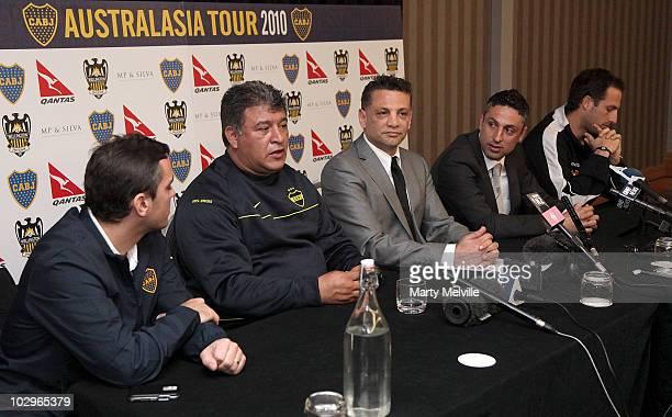 Boca Juniors head coach Claudio Borghi talks to the media with Phoenix owner Terry Serepisos assistant Phoenix coach Luciano Trani Captain of the...