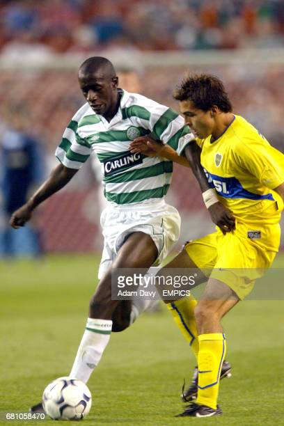 Boca Juniors' Jose Marie Calvo and Celtic's Mohammed Sylla battle for the ball