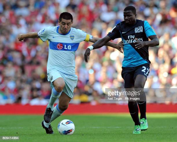 Boca Juniors Juan Riquelme and Arsenal's Emmanuel Eboue battle for the ball during the Emirates Cup match at the Emirates Stadium London
