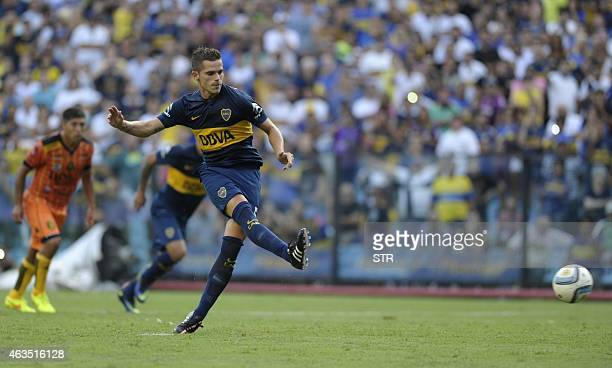 Boca Juniors' midfielder Fernando Gago kicks to score a penalty against Olimpo during their Argentine first division football match at 'La Bombonera'...