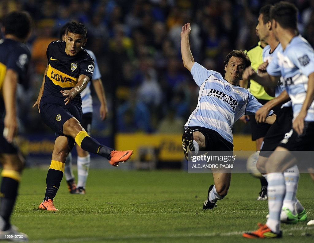 Boca Juniors' midfielder Leandro Paredes (2nd-L) kicks the ball to score against Racing Club during their Argentine First Division football match, at the Bombonera stadium in Buenos Aires, Argentina, on November 25, 2012. AFP PHOTO / Alejandro PAGNI