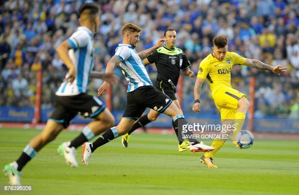 Boca Juniors' midfielder Nahitan Nandez controls the ball past Racing's defender Miguel Angel Barbieri during their Argentina Superliga First...