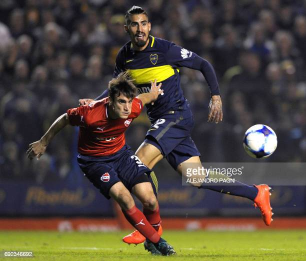 Boca Juniors' midfielder Oscar 'Junior' Benitez vies for the ball with Independiente's defender Nicolas Tagliafico during their Argentina first...