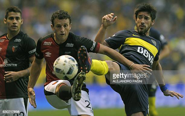 Boca Juniors' midfielder Pablo Perez vies for the ball with Colon's mifielder Pablo Ledesma during their Argentina First Division football match at...