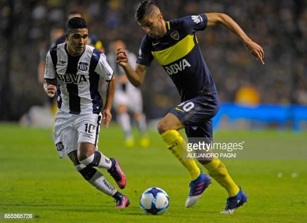 Boca Juniors' midfielder Rodrigo Bentancur controls the ball past Talleres' midfielder Emanuel Reynoso during their Argentina First Division football...