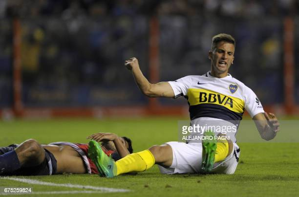 Boca Juniors' midfielder Rodrigo Bentancur reacts after missing a chance of a goal against Arsenal during their Argentina First Division football...