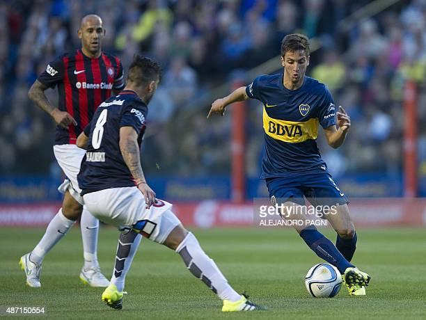 Boca Juniors' midfielder Rodrigo Betancur vies for the ball with San Lorenzo's midfielder Enzo Kalinski during their Argentina First Division...