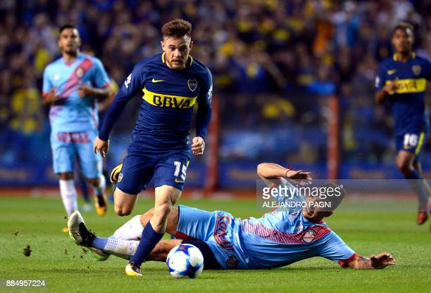 Boca Juniors' midfielder Uruguayan Nahitan Nandez controls the ball past Arsenal's defender Facundo Cardozo during their Argentina First Division...