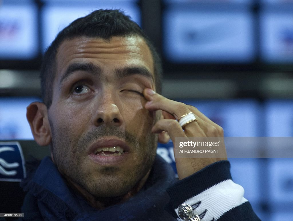 Boca Juniors' newly returned player Carlos Tevez answers questions at a press conference held during his official presentation at La Bombonera stadium in Buenos Aires, on July 13, 2015.