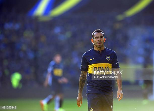 Boca Juniors' newly returned player Carlos Tevez gestures during their Argentina First Division football match at La Bombonera stadium in Buenos...