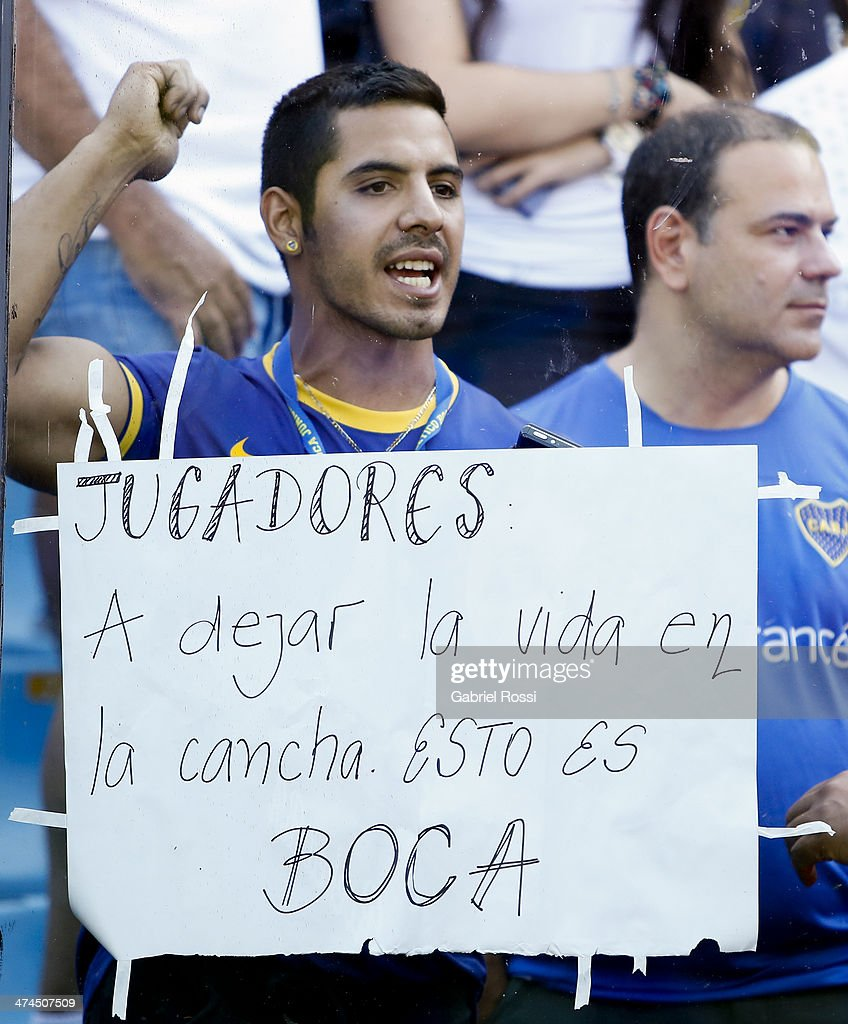 Boca Juniors shows a sign demanding players to play for their lives during a match between Boca Juniors and Estudiantes as part of forth round of Torneo Final 2014 at Estadio Unico de La Plata on February 23, 2014 in La Boca, Buenos Aires, Argentina.