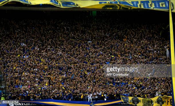 TOPSHOT Boca Juniors supporters celebrate after their team defeated Union and won Argentina's first division football championship at La Bombonera...