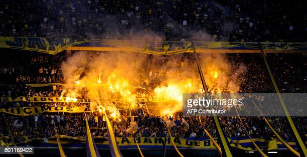Boca Juniors supporters celebrate after their team defeated Union and won Argentina's first division football championship at La Bombonera stadium in...